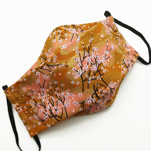 Masque de protection en tissu japonais branches de cerisiers sur fond rose orangé et bronze