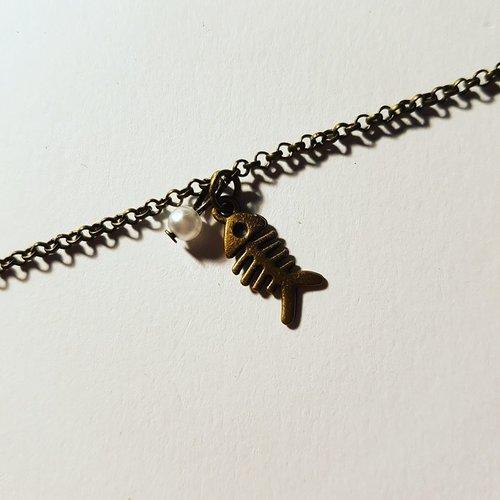 Bracelet poisson et perle blanche