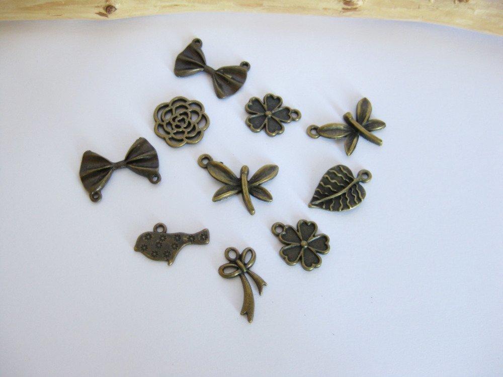 Lot de 10 breloques fleurs/ noeuds - couleur bronze