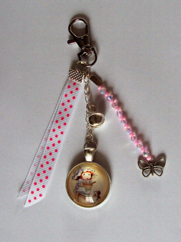 Porte clé, bijou de sac argenté avec cabochon en verre petite fille rétro