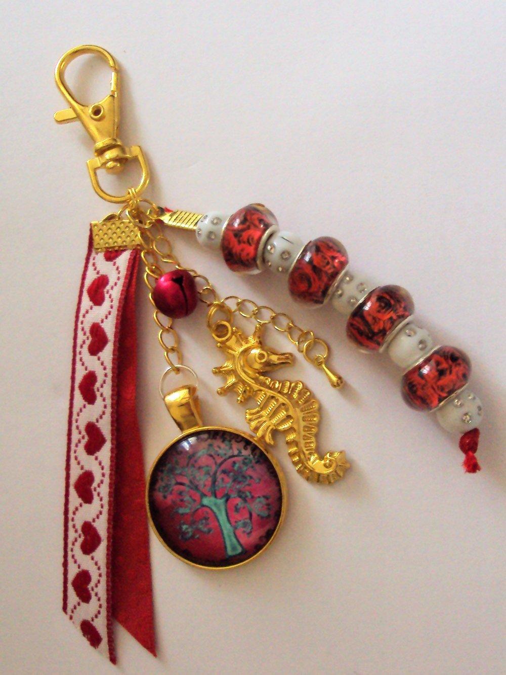 Porte clé, bijou de sac doré avec cabochon en verre arbre de vie