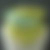 Tour de cou réversible en polaire apple et coton pois mousse sur fond aqua fermé par bride et bouton(s).