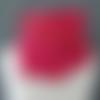 Tour de cou réversible en micropolaire berlingot et coton rubis éclatant foncé à pois fermé par bride et bouton(s).