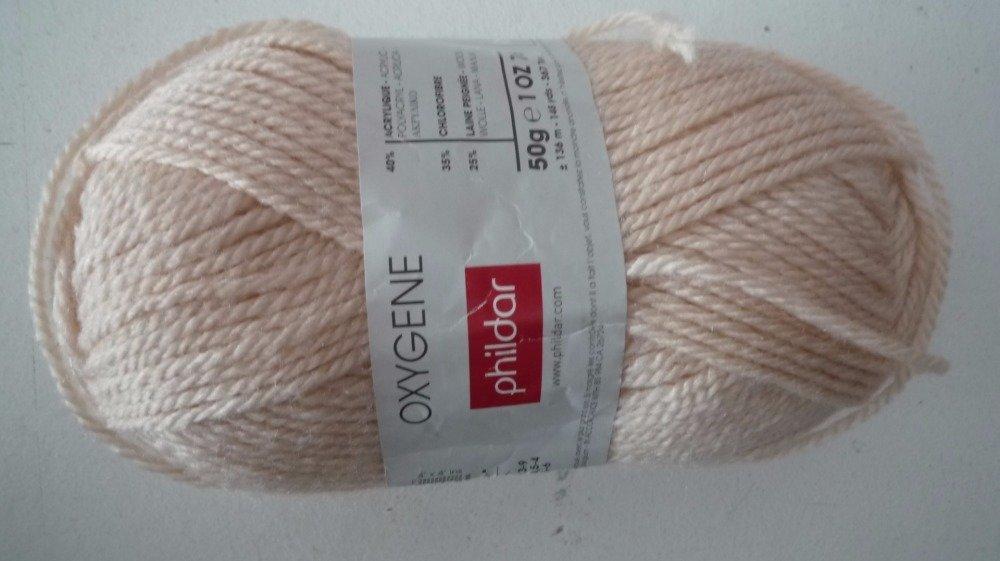 9 pelotes laine mélangée beige clair (rosé)