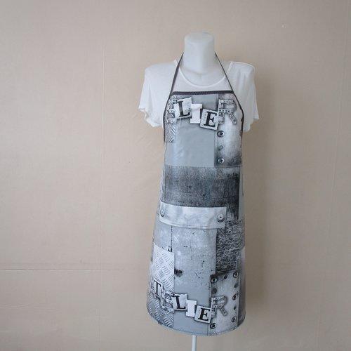 Tablier femme en toile cirée de couleur noire, grise et blanche motif industriel