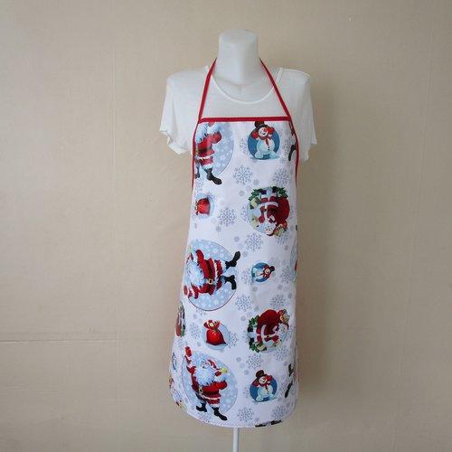 Tablier femme en toile cirée de couleur blanche avec des pères noel rouge et blanc