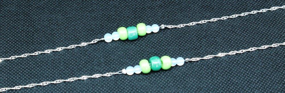 Cordon de lunettes bijoux en perles dans les tons vert