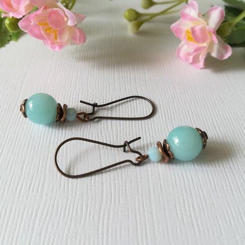 Boucles d'oreilles apprêts cuivre et perles en verre bleu ciel