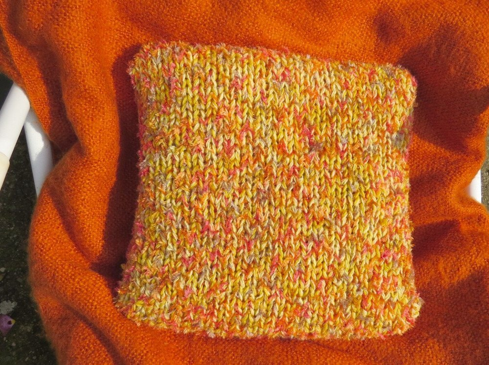 Housse de coussin multicolore orange à torsade