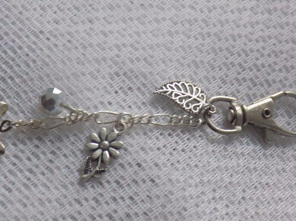 Bijoux de sac argent,chaînette,cabochon verre motif fleur,breloques.