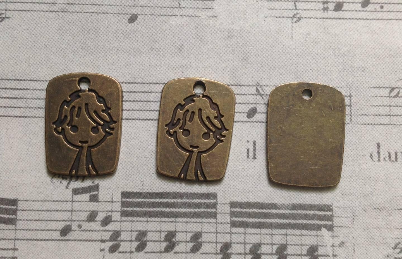 3 breloques étiquette au motif garçonnet en métal couleur bronze 12x17mm
