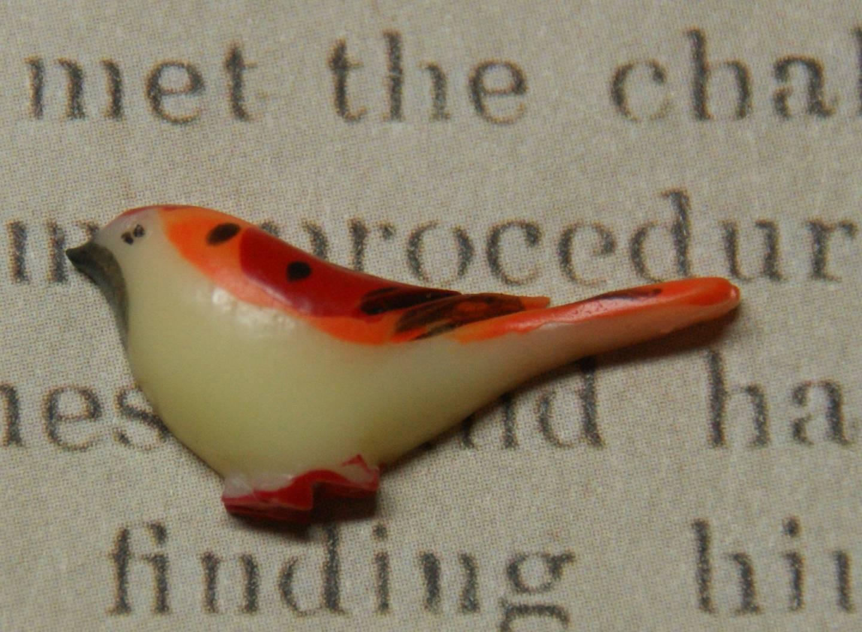 Applique oiseau orangé en résine 28x12mm