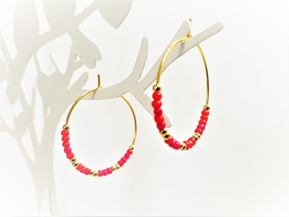 boucles d'oreilles ,créoles ,rouge ,dorée