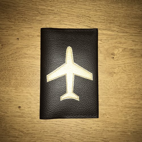 Protège passeport avion or/ébène