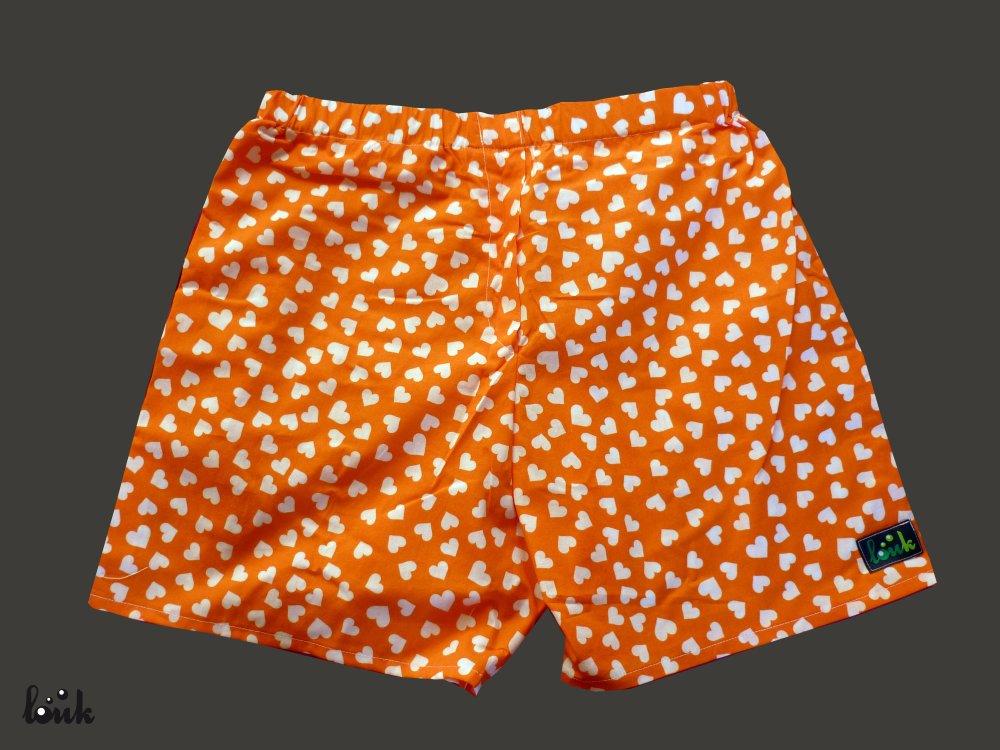 Caleçon homme orange à coeurs blancs