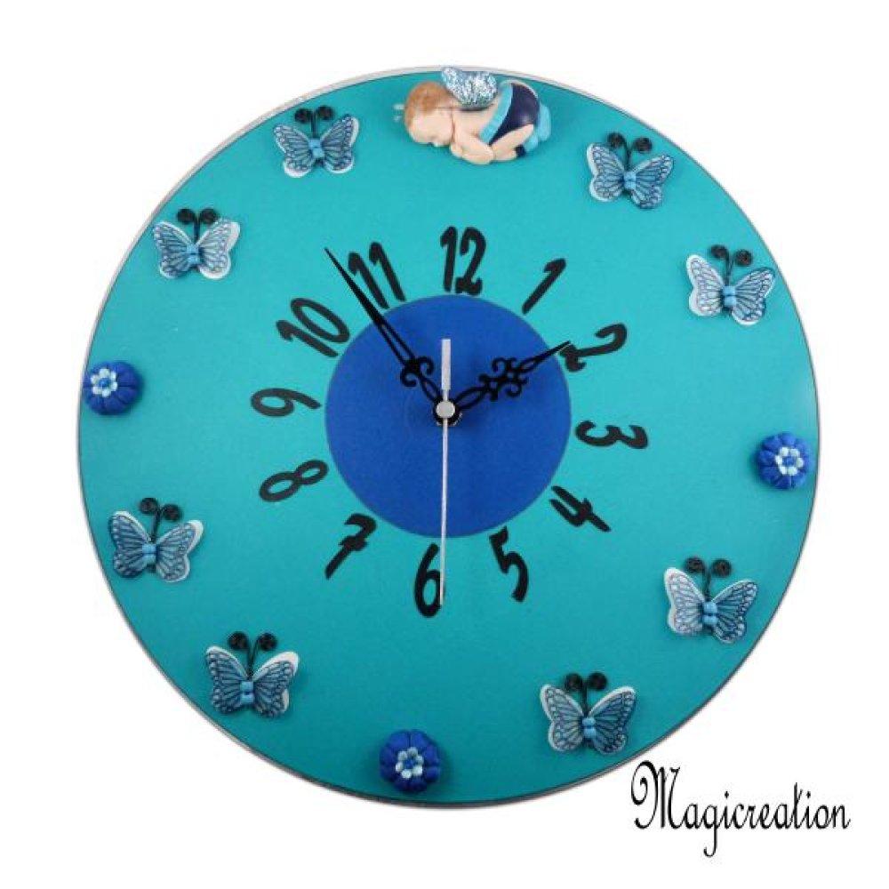 """horloge murale silencieuse """"le rêve du bébé papillon"""" en turquoise et bleu sur disque vinyle 33 tours recyclé"""