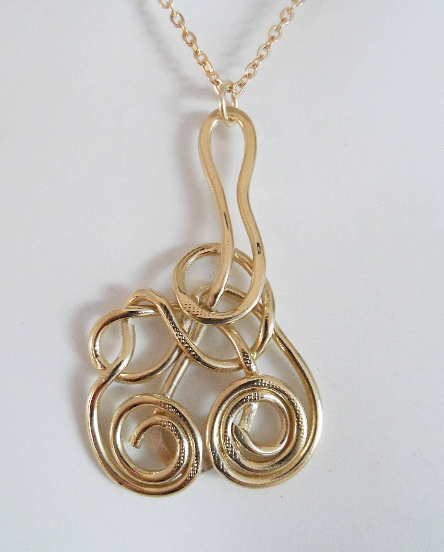 Pendentif spirales dorées lien noué