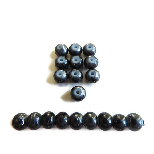 19 perles en verre noir et imprimées