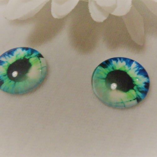 Cabochon en verre rond de 18 mm / 1.8 cm thème fantastique: oeil, pupille, fleur, moderne1