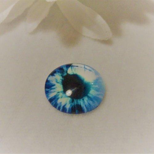 Cabochon en verre rond de 18 mm / 1.8 cm thème fantastique: oeil, pupille, fleur, moderne2