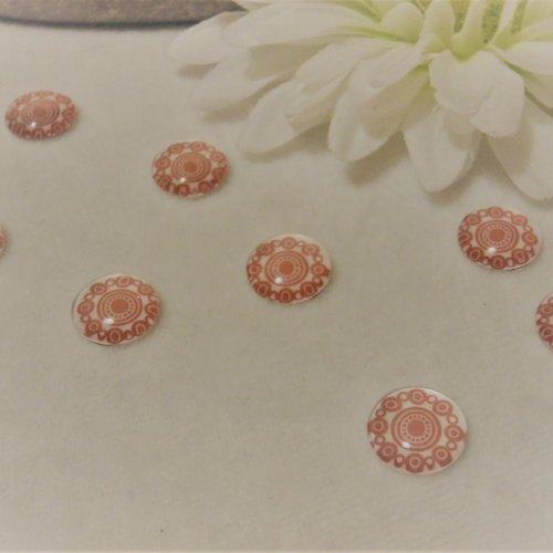 Lot de 2 cabochons en verre de 12 mm / 1.2 cm thème: des ronds, des illusions,du graphisme blanc et rose