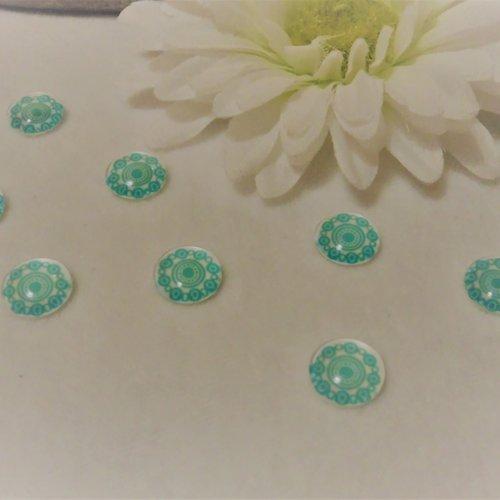 Lot de 2 cabochons en verre de 12 mm / 1.2 cm thème: des ronds, des illusions,du graphisme blanc et bleu turquoise