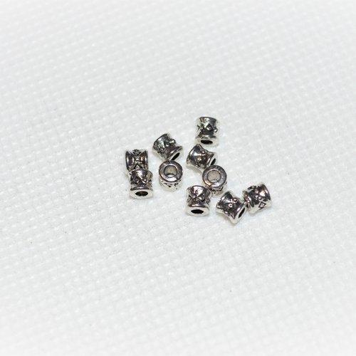 Lot de 130 perles en métal argenté