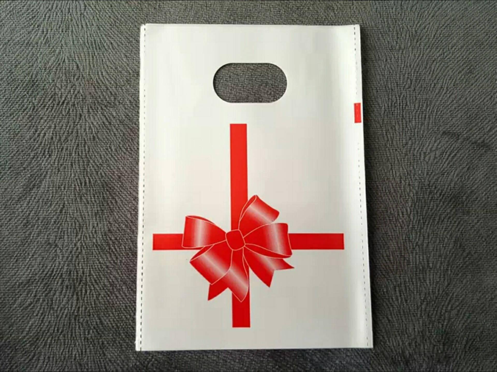 Lot de 100 Sacs 10cm Pochettes Cadeaux Plastique Décor Paquet Cadeau Noeud Rouge RAF C5