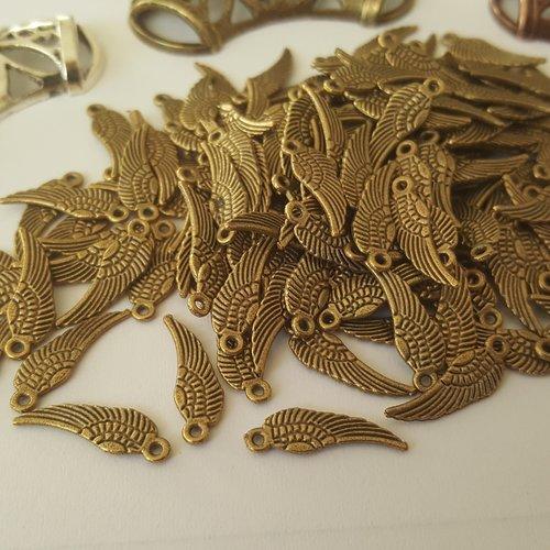 10 breloques mini aile d ange oiseau 17mm en métal bronzé couleur bronze a31