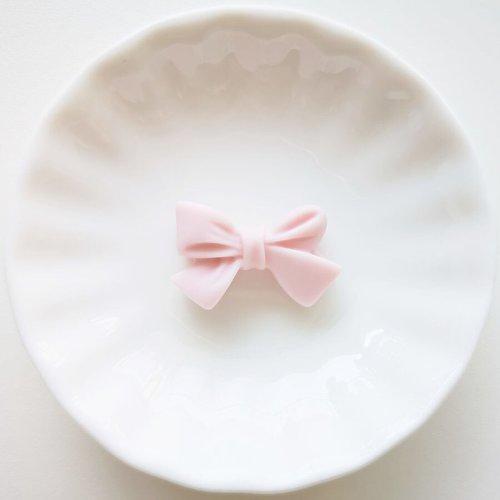 Perle en silicone noeud papillon 27mm x 17mm rose clair, creation bijoux