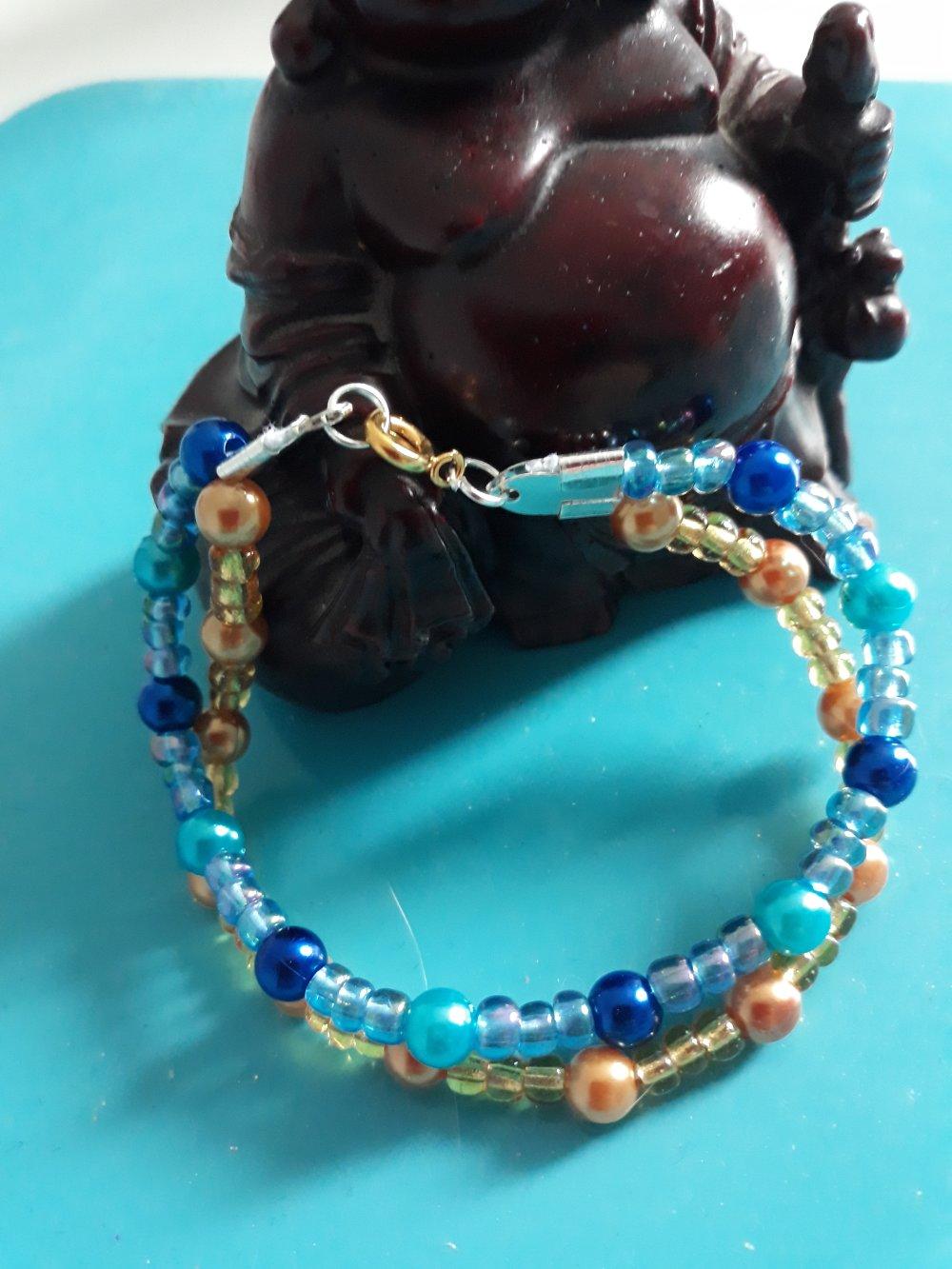 Bracelet deux en un de deux couleurs doré et bleu avec fermoir mousqueton en métal argenté