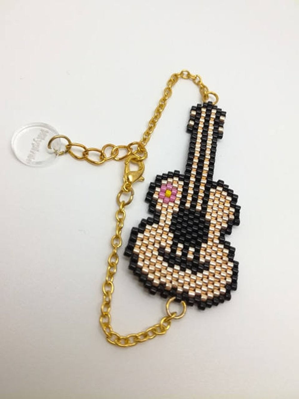 Bracelet guitare tissé en perles miyuki delicas