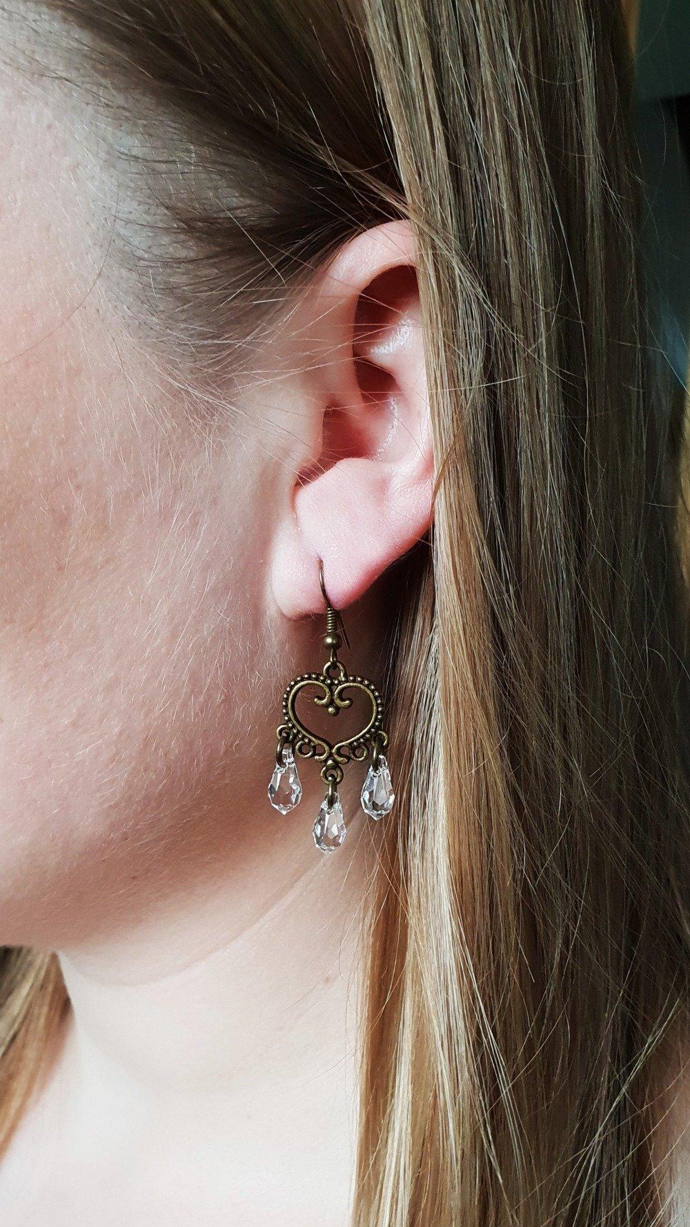 SWAROVSKI Boucles d'oreilles cristal blanc gouttes / bronze