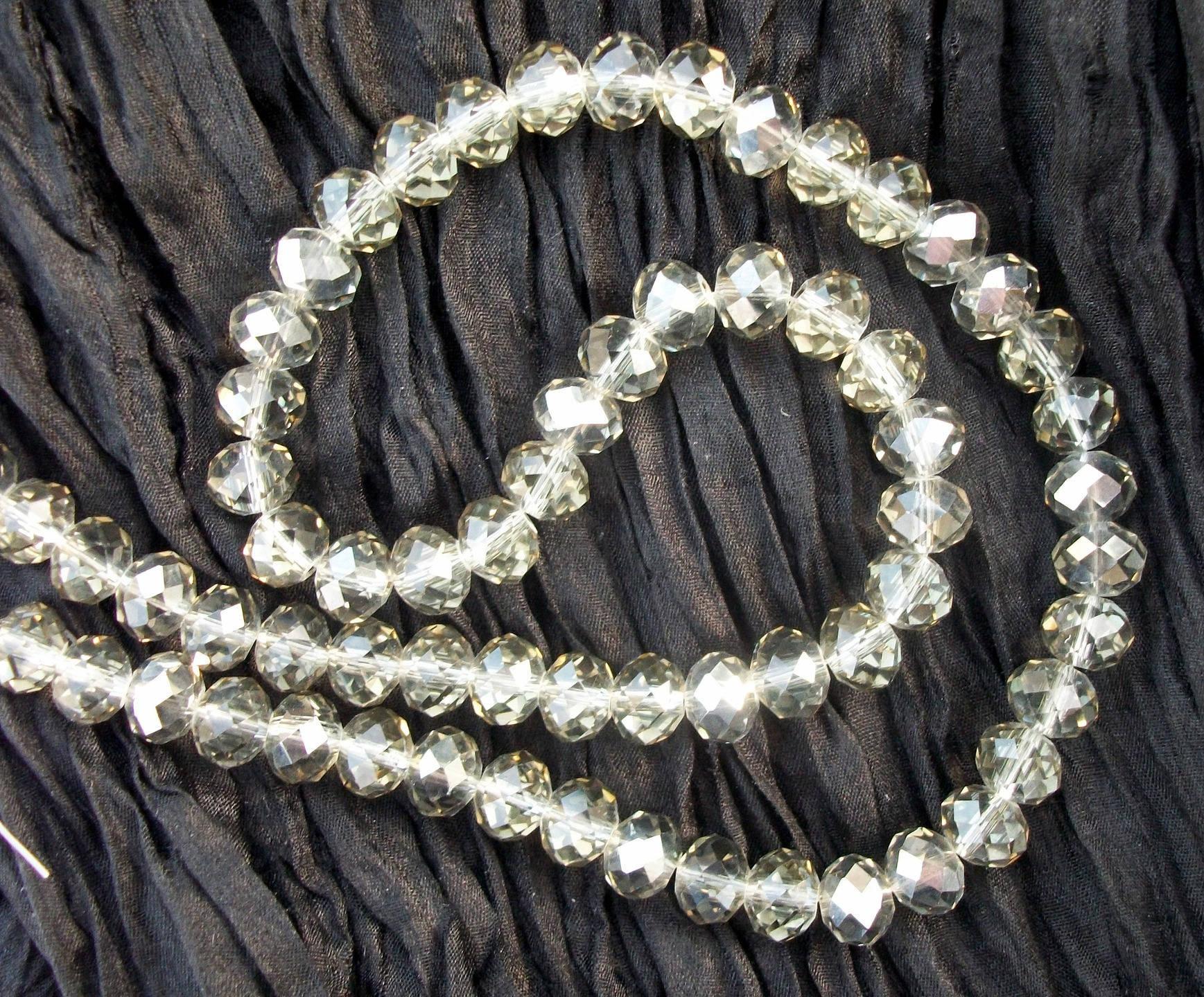 Perles de cristal Swarovski 6 x 8 mm grises irisées (x5)