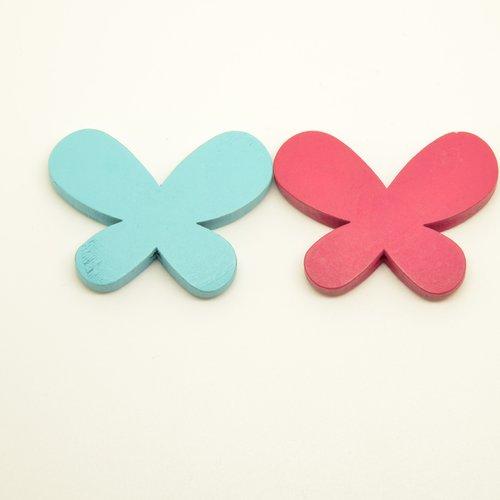 2 perles papillons en bois - turquoise + rose fuchsia