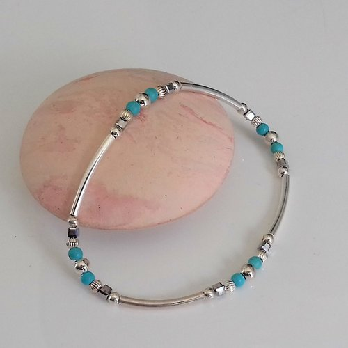 Bracelet tubes argent et perles bleu turquoise élastique