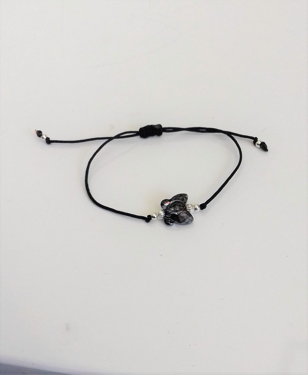 Bracelet  papillon noir cristal swarovski  sur cordon