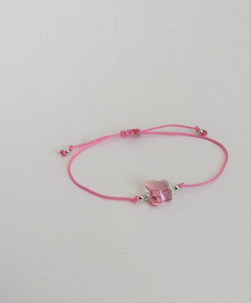 Bracelet  papillon rose cristal swarovski  sur cordon