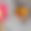 Perle tête petite fille à la tresse et noeud violet en pâte polymère ou fimo