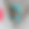 Perle petit garçon au casque bleu personnage kawaïï en pâte polymère ou fimo
