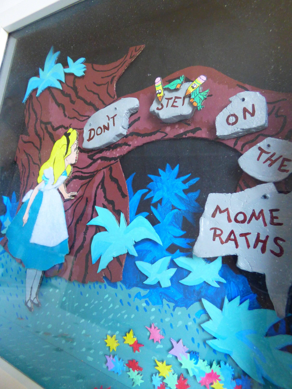 "Cadre-vitrine Disney Alice ""Don't Step on the Momeraths"" 25x25"