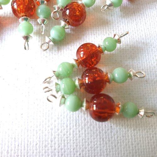 2 connecteurs perles rondes, verre craquelé orange, perles opaques vert d'eau, toupies métal argenté
