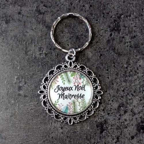 Porte clés joyeux noël maitresse à customiser cabochon résine de 25mm. médaille/ pendentif argenté vieilli.