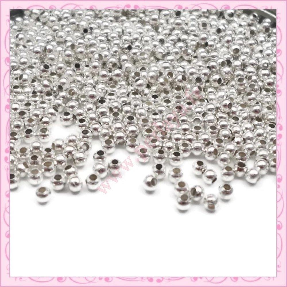 Lot de 2000 perles rondes en métal argentées 2.4mm (Ref:002637)