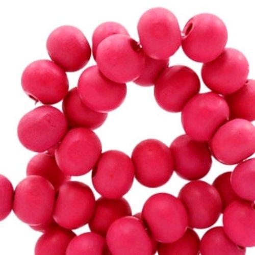 50 perles rondes en bois ø 8mm couleur rose fuchsia