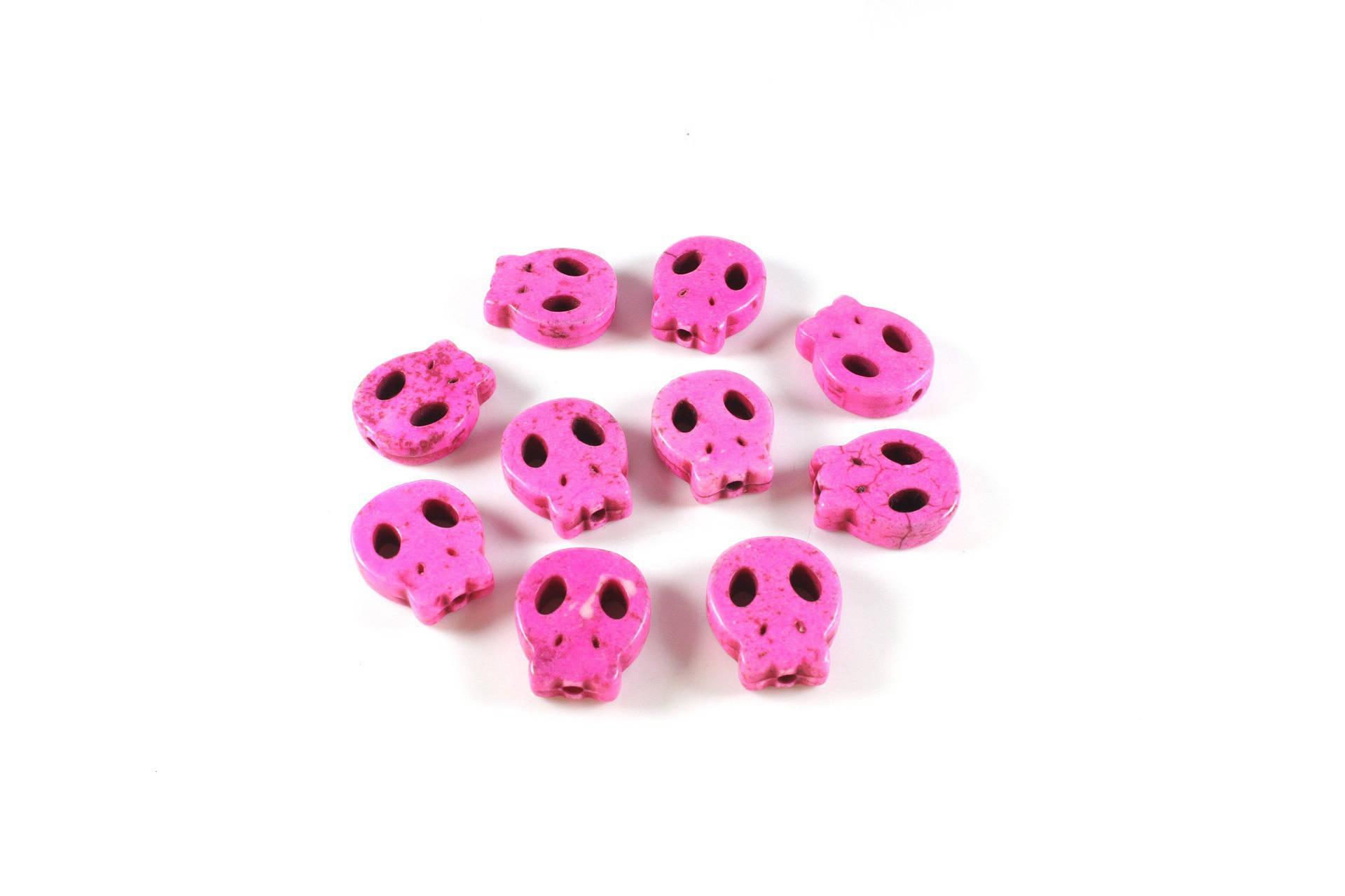 10 perles crâne plat en turquoise synthétique rose  +/- 15 x 13 x 4mm