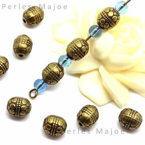 20 perles toupies striées décorées couleur bronze diamètre 4 mm