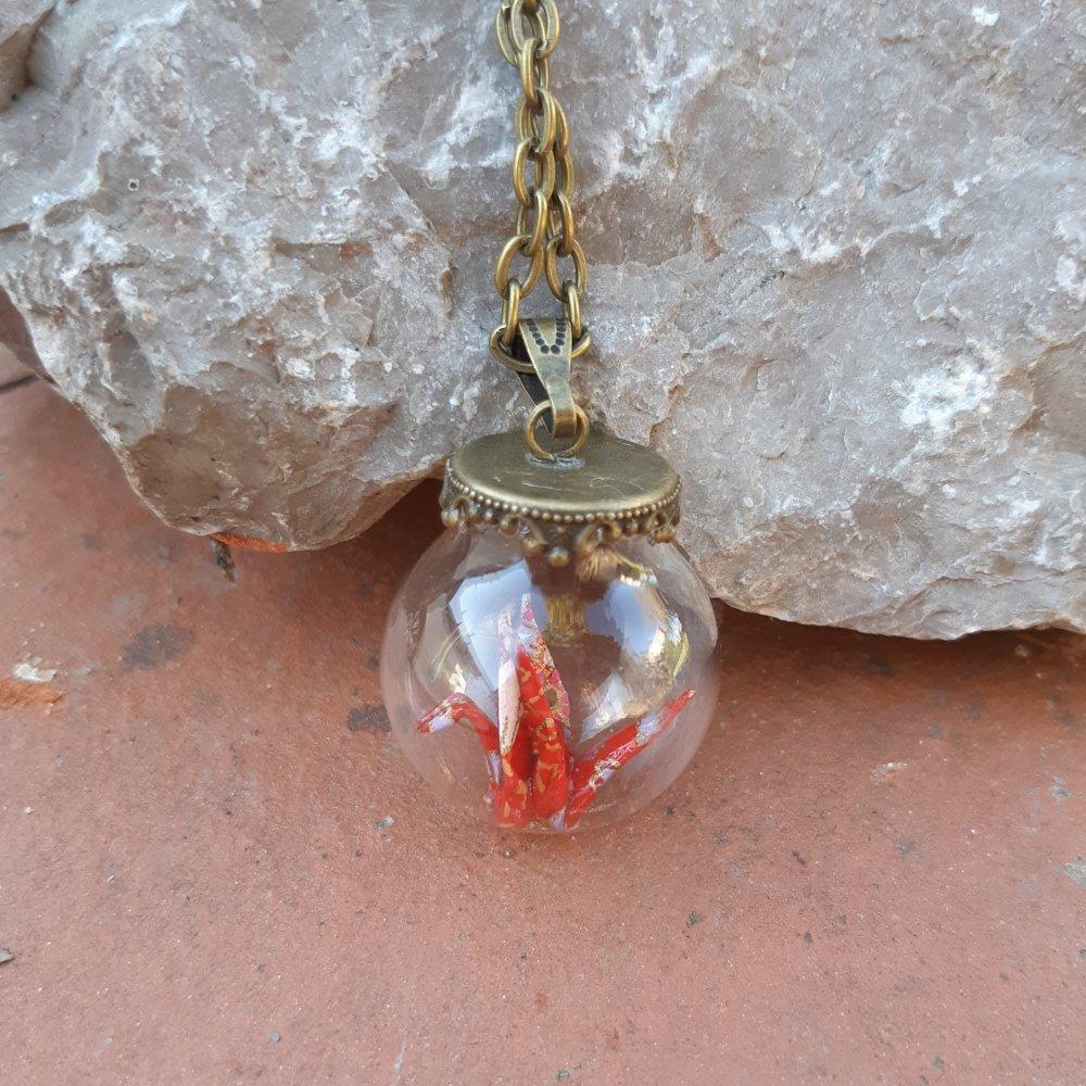 Sautoir avec pendentif fiole grue rouge
