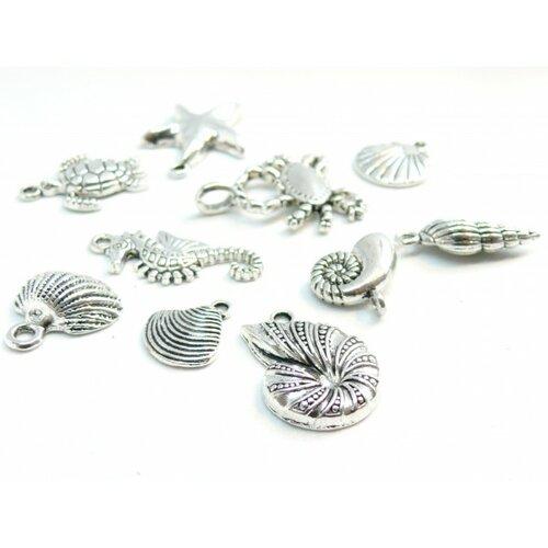 S11207652 pax 9 pendentifs thème océan,coquillage, etoile, crabe métal couleur argent antique