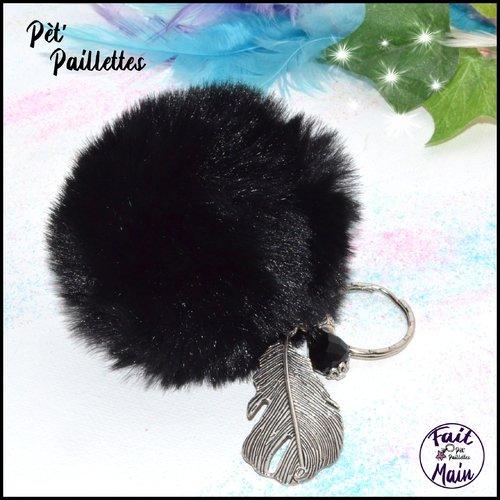 Porte clés grand pompon noir et plume argenté